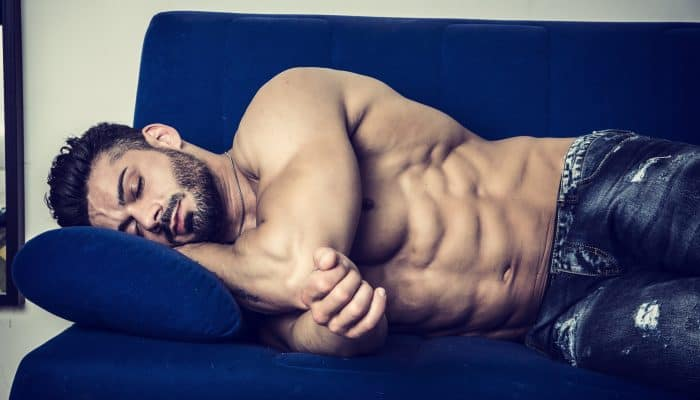 Muscular shirtless bodybuilder sleeping